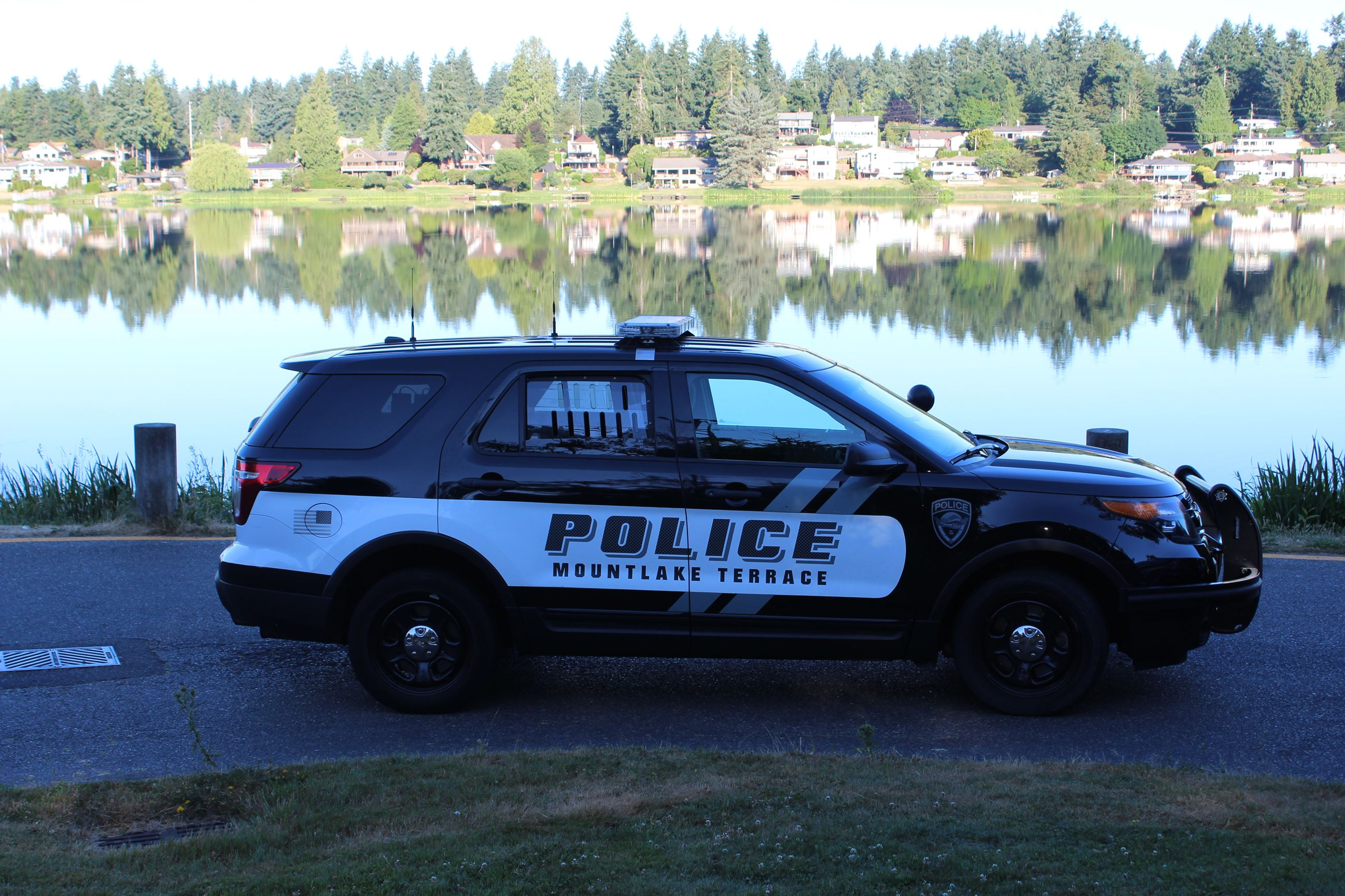 Police Car by Lake Ballinger
