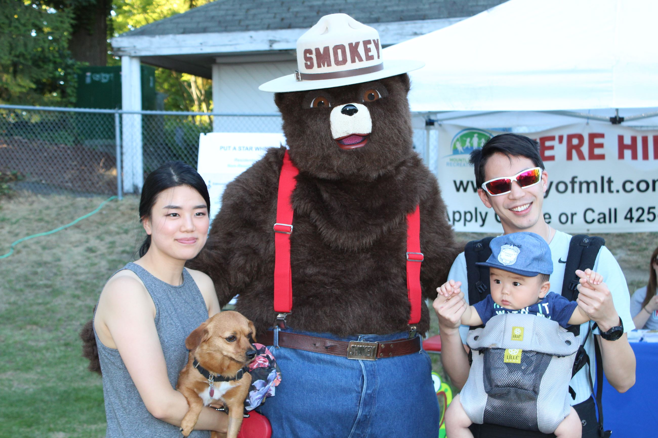 Smokey Bear with family at event